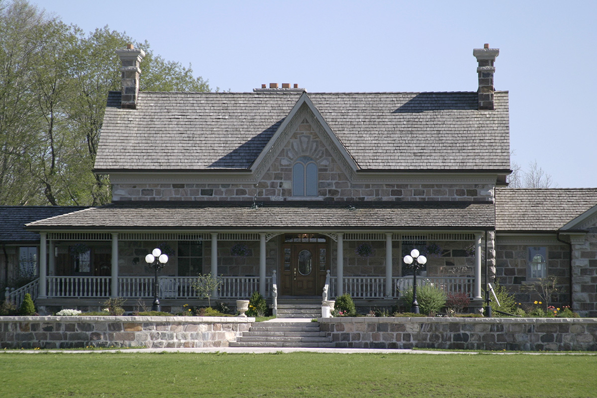 This new fieldstone house design was based on the Ontario farmhouse plans