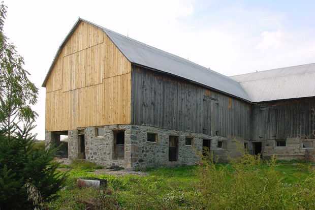 """""""Before"""" exterior shows the 100-year-old animal barn waiting for a new purpose."""