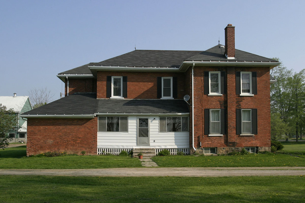 Before... A classic two-storey farmhouse ready for some updates.