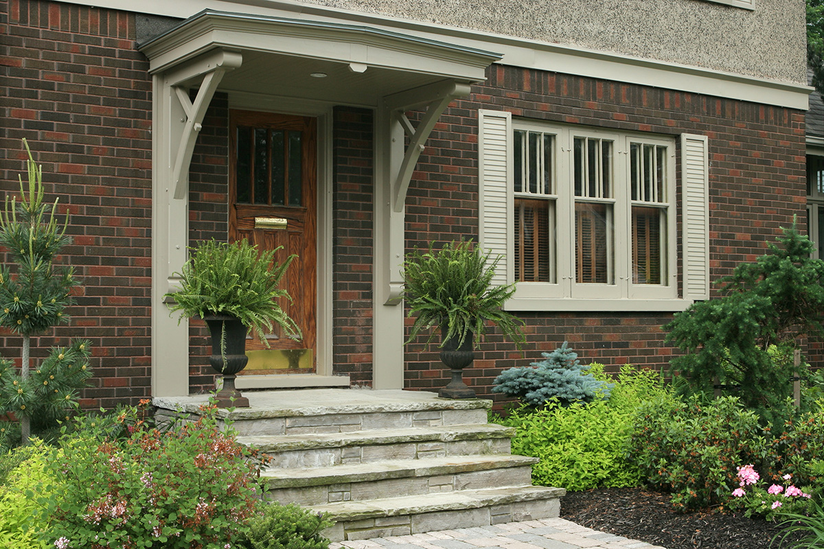 This exterior update included a new entrance canopy and stone steps.