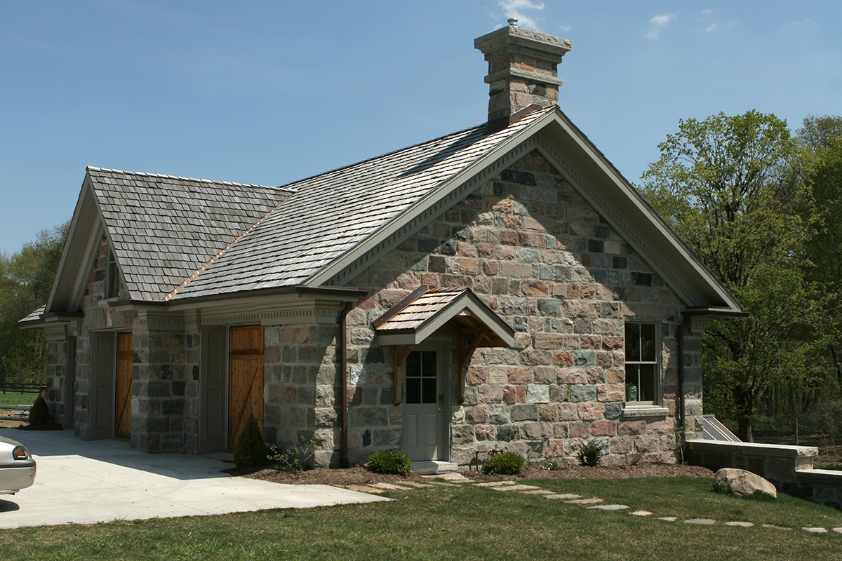 New Building: Stone garage with 3 bays front and 3 bays rear.