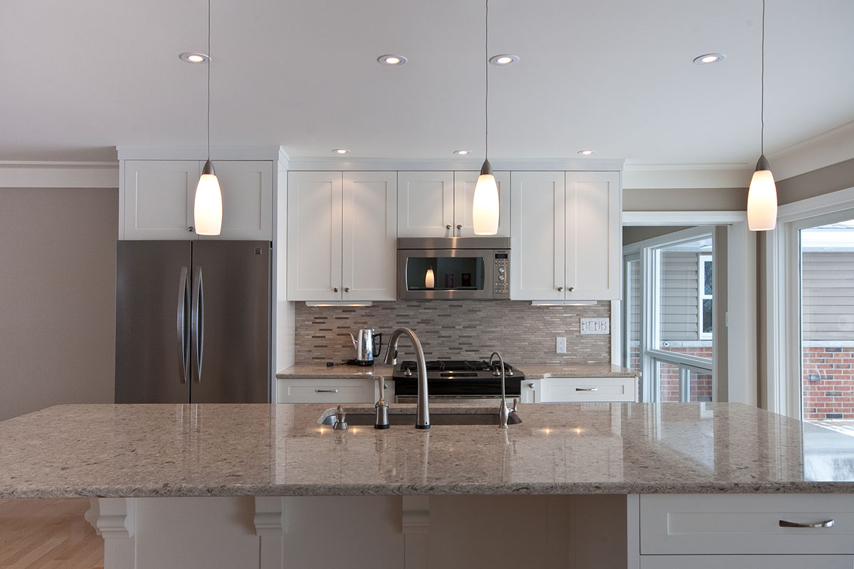 New kitchen with granite-topped island.