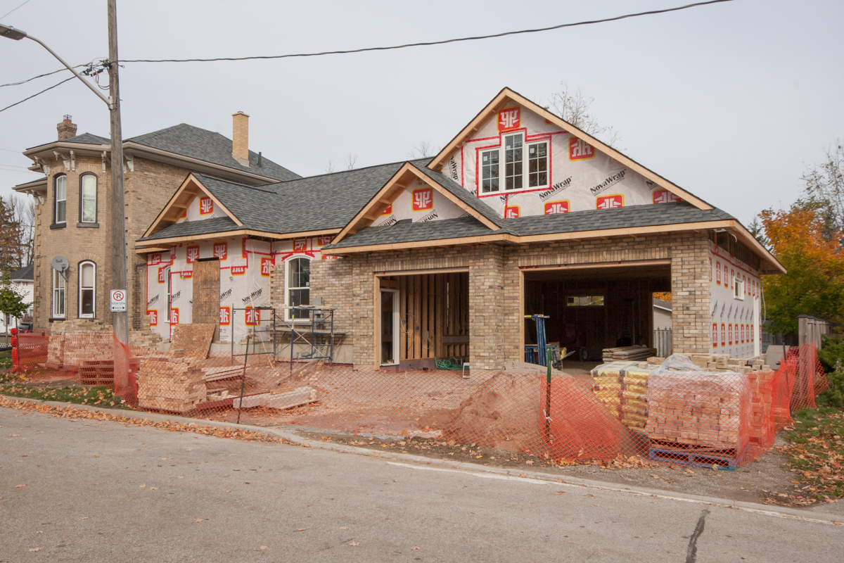 New foyer, laundry, mudroom and garage addition to this stately two-story.