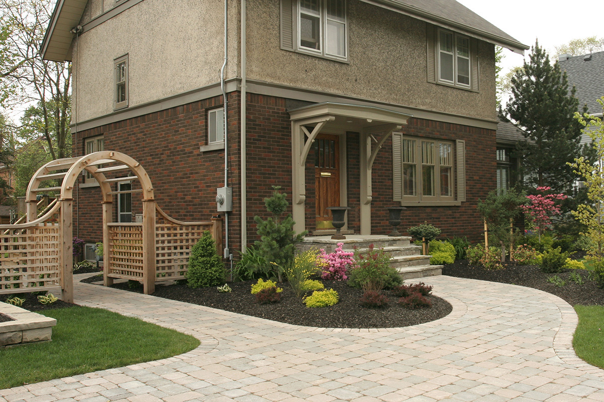 The finished design with stone planter and landscape plantings.